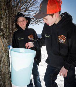 grandkids checking the sap buckets